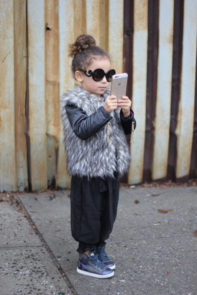 Stylish Nyc children style. mini blogger learning to take pictures.